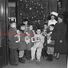 (12.29.1955) Christmas cheer was delivered to patients of Shamokin Hospital by a group of Cub Scouts from Pack 3255, St. Edward's Church. Pictured are, from left, Gilbert Chamberlain, Julies Christiana, Thomas Herrityy, Thomas Webb, Louis Karzenuaki, a patient, William Gilger and James Christiana. Looking on are Margaret Bradley, a nurse and Leona Chamerlain, den mother.