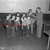 (02.02.1956) Cub Scouts of St. Joseph's Church prepare to play volleyball on Feb. 2, 1956. Pictured are Jack Linch, chairman of the Cub Pack, directing the game; first row, James Richardson, Thomas Eckman, Michael Cunningham, Richard Christian and Paul Sheetz; second row, Patrick Rutkaskie, Michael Lynch and Ronald Hager.