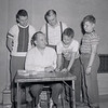 Mr. Evans signing boys up for baseball. Pictured are R.Y. Evans, Johnny MacElwee, John Young, Bernie Hoy and Al Strunk.