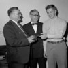 (04.26.53) Bill Clements of Coal Township High School is presented with a Bible from the Gideon Society. Representatives from the society are H.A. Forry, center, and James C. Ney.