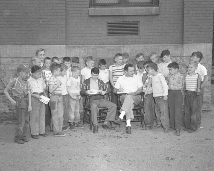(1950 or 51) Youngsters signing up for football at the Lincoln School.