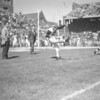 (10.05.52) Limbering up his kicking toe before game time is Ed Binkoski, former Coal Township football star, before the battle between Penn State and Notre Dame.