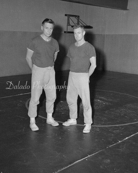 Wrestling coaches, unknown.