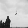(1956) Air Force helicopter lands on Market Street in Mount Carmel to publicize the VFW sponsored bloodmobile. George Kerestes, of VFW, and Sgt. Ben Mancini, of Sunbury Air Force recruiting office, greeted the airmen.