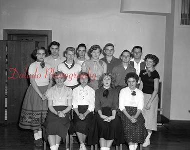 "(10.20.55) Cast of characters in a three-act comedy at Trevorton High School are, seated, from left, Nancy Revak, Cecelia Sienkiewocz, Mary Konyar and Sandra Vesnefskie; standing, Sally Kehler, Glen Strausser, Dennis Erdman, Bob Sagar, Joyce Erdman, Bill Waefe, John Lesinskie, Jim Burke and Beverly Klemick. The play was entitled ""Deadly Ernest."" Mrs. George Clark is the adviser."