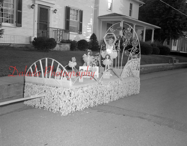 (Sept. 1955) Ballet in miniature is Joan Adams, daughter of Mr. and Mrs. Clyde Adams, was a top prize winner in the decorated floats category in the eighth annual pet parade for All Home Days in Elysburg.
