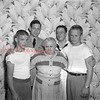 (06.12.1952) The Ramage family together for a photo before two brothers go off to war. Herbert and Robert Ramage, second and third from left, bid farewell to their mother before leaving for duty with the Navy. Also pictured on June 12, 1952, are James Saul and George Meyers, Naval recruiters. Mr. and Mrs. Thomas Ramage, 224 S. Chestnut St., Mount Carmel, are the father and mother of 12 children, including seven boys who joined the Navy.