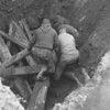 (Feb. 1961) Workers at Savitski Brothers Coal Co. assist in choking a huge mine cave-in at the east end of the Atlas playground along Mulberry Street. The hole is 14 by 14 feet and about 40 feet deep. Ed Savitski reported that this was about the fifth cave-in within a 10-yera period.
