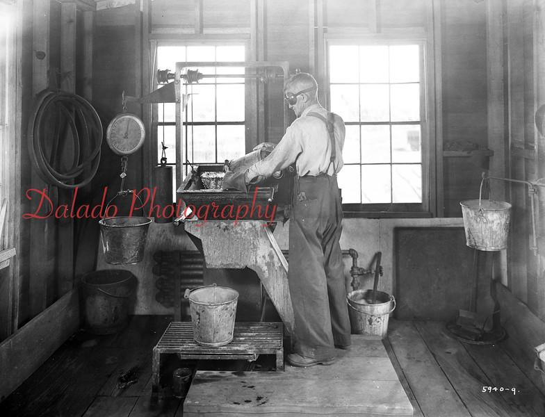 Man weighing coal.