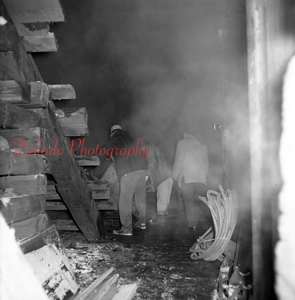 (1965) Miners following a small fire.
