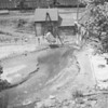 Removing sludge at this unknown location in either 1950 or 1951.