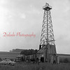 (July 1956) Farmer's Well No. 1 near Numidia. The derrick has been pounding a hole into the earth for the last six months. Hole has to reach 4,590 feet in order to reach the Oriskany sand.