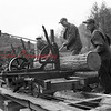 (03.19.53) Jacob Leisenring Saw Mill, Bear Gap, is shown. Cutting the wood are Harry Krock, Willard Wolfgang and Harry Roup. The mill can produce about 1,000 feet of lumber every hour.