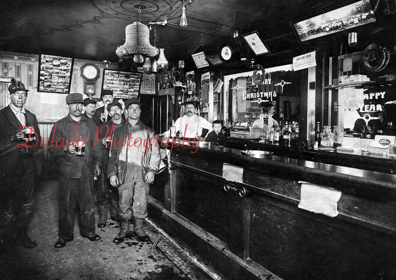 (January 1912) Kulpmont first hotel. Behind the bar is John Clauser, the propritor, and his son Alfred.