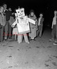 (Oct. 1954) First Kulpmont Halloween Parade. Sponsored by Lions Club. A total of 500 people participated. Mechanical man is Billey Bressi.