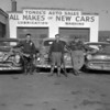 (Dec. 1958) Men with deer at Tomol's Auto Sales along Route 122 (Route 61) in Kulpmont.