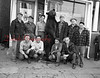 (11.19.53) A group of Kulpmont hunters gather around a prize 300-pound bruin, which was shot in Tioga County. The bear was killed by Leonard Oszka, who used five shots from his 35 Remington rifle. Members of the hunting party are, kneeing, Russ Goretsky, John Oszko Jr., Clem Laskoski and John Bartos; standing, Thomas Smith, Steve Zarlinski, Donald Dallatore, Leonard Oszko, Leonard Wydra, and Anthony Kaminski.