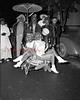 (Oct. 1954) First Kulpmont Halloween Parade. Sponsored by Lions Club. A total of 500 people participated.