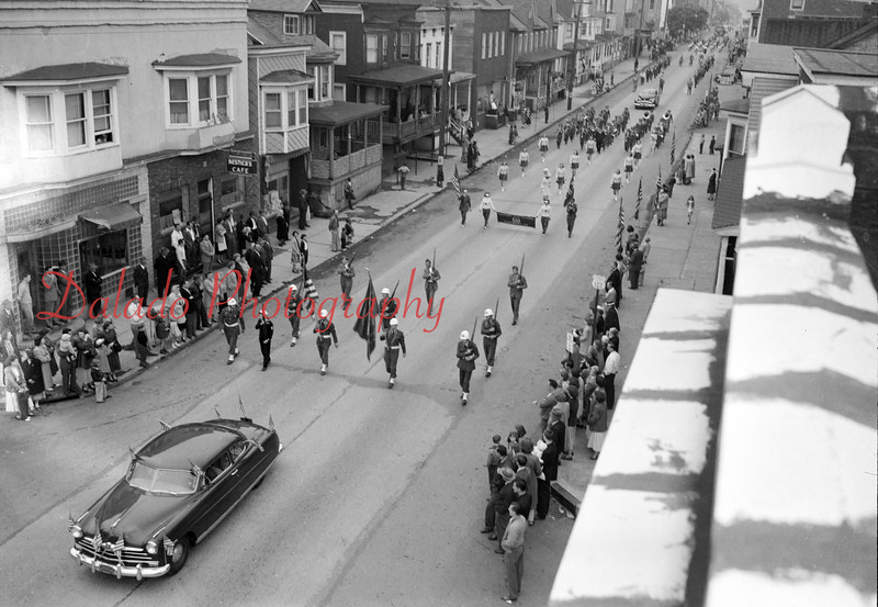 A parade, unknown year, on Chestnut Street going by Tenth Street.