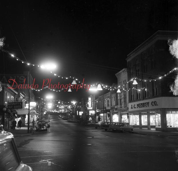 (12.18.66) Christmas lights over Oak Street.