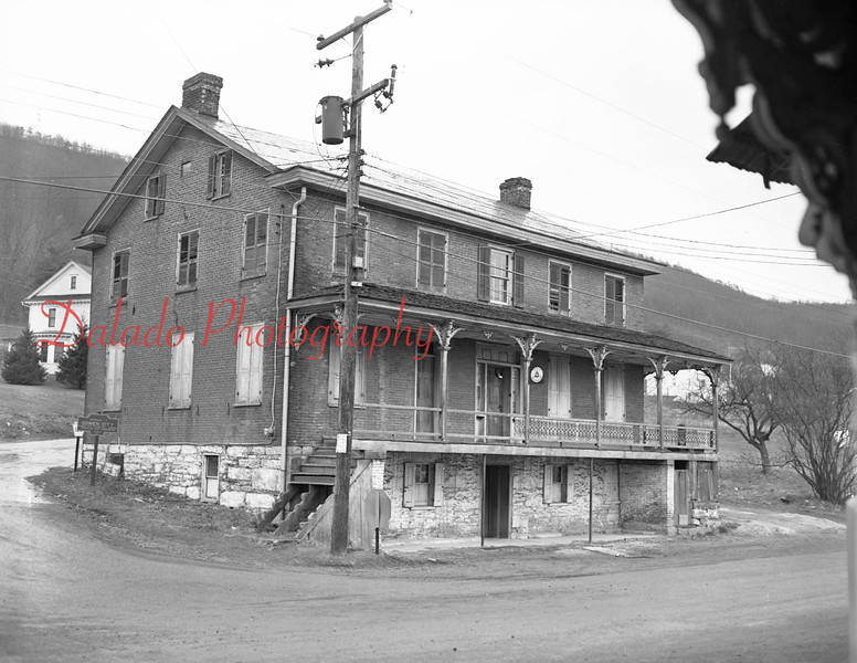 (12.31.1953)  Oldest building in Gowen City, erected in 1852. Operated by Mickey Kerstetter. Formelly known as the Brick Hotel. Here it is shown on Dec. 31, 1953.