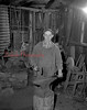 (May 1954) Wes Long, one of the few remaining blacksmiths, is shown in his shop in West Cameron Township.