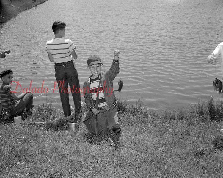 (06.26.1958) Zerbe Rod and Gun Club derby on June 26, 1958. Nine-year-old Jack Deppen catches a fish.