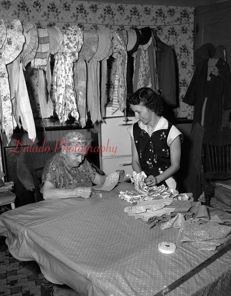 (03.08.1956) Grace Shock is cutting a pattern for a bonnet. Also pictured, at right, is Neva Lucas. Members of Trevorton Centennial Committee.