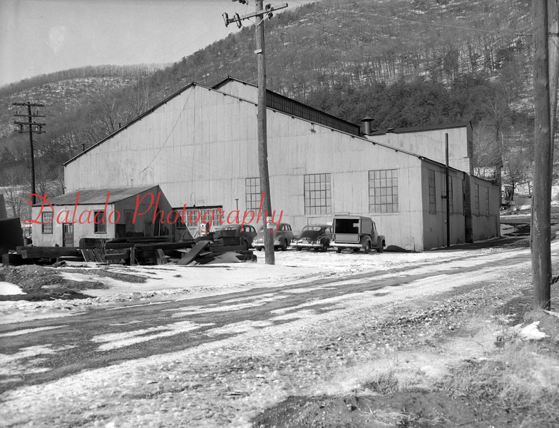(1957-58) Deibler Station. The road in view is Short Road and lies to the east of the building. It drops down from the highway and crosses Shamokin Creek. The building housed anthracite briquette making plant until, or shortly after World War II.