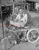 (June 1955) Decorated with all sorts of ornaments is this bicycle owned by Arnold Weikel, of Gowen City. Included are 50mm gun shells, horns, mirrors and a windshield with souvenir buttons.
