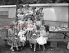 (08.07.1952) Participants in a doll show at Trevorton community playground are front row, from left, Bonnie Baker, Dianna Gilchrist, Nyla Shaeffer and Sandra Swinhart; second, Margaret Meyer, Renee Derk, Belva Mae Sherman, Joyce Kline and Justice Smith; third, Shirley Baker, Joanne Michetti, Mary Brosious and Adelia Whary.