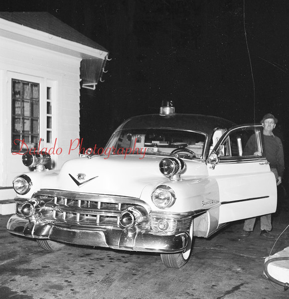 (Nov. 1960) John Coddington with Centralia's first ambulance.