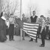 (Nov. 1960) A grade school in Centralia was given a flag that at one point was at the nation's capital. It was first given to James Cleary, Centralia fire chief, who received it from a congressman. Students shown are Vincent Kimsel, Theodore Buriak and Jerome Mahoney. Mother Maria Aloysius is at left.