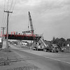Dismantling of Reading Railroad bridge over Route 54 at Strong. The Pennsylvania line is shown crossing the road. This is at the future intersection of Routes 54 and 61, looking toward Kulpmont.