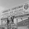 (May 1963) Shown with sign near Frackville Industrial Park to grab Gov. Scranton's attention are George Shroyer, vice president of the Anthracite Expressway Association; Richard Guinan, president of the Mount Carmel Industrial Fund; and William Yoder, president of the association