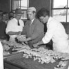 (05.19.55) Junior Chicken of Tomorrow contest at Mandata Poultry. Judges are Kermit Birth and Harry Kauffman, of Penn State University, and Kendall Merritt, of the state Bureau of Markets of Harrisburg