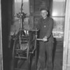 (12.08.55) Bill Klock is shown winding the Trevorton town clock. Klock, a custodian, has wound the clock for 18 years. He lives at 325 Coal St. The clock was erected in March 1915 as a memorial to Christian H. Kramer.