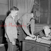 (07.17.1952) Robert Redman, Paxinos, applies for a license with State Police Cpl. Lawrence Carson.
