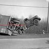 (Dec. 1954) Driver escaped injury when a brake failed on a sharp hill on Route 122. Driven by John Bedway, Schuylkill Haven.
