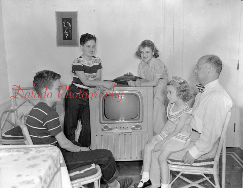 (06.07.1951) Family with a modern TV.