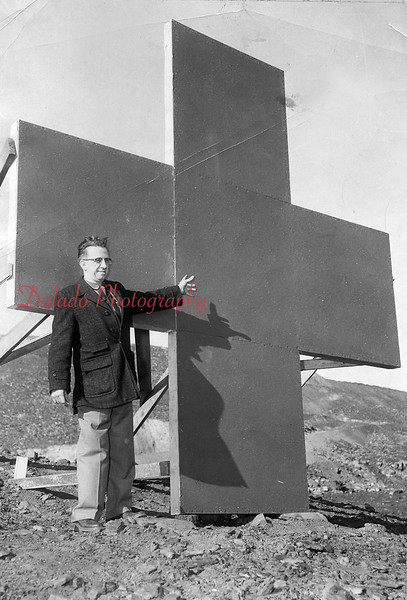 Emerson Hollenback showing his idea for a Red Cross drive. The cross was placed on the Glen Burn.