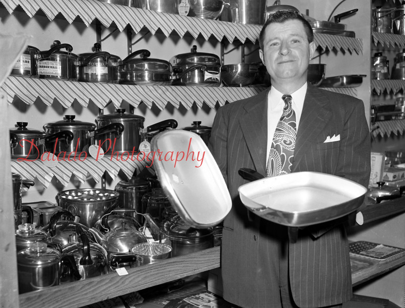 Mike Novack displaying some nifty pans at Peters Hardware,