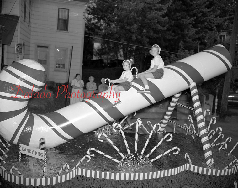 (Sept. 1954) Huge candy cane in a parade, maybe All Home Days.