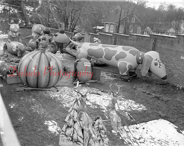 (11.28.53) Crowds lined Independence Street to view one of the most unusual parades ever staged in Shamokin. The Jean Gros Balloon Parade featured animals and figures from fiction, nursery rhyme and fantasy. The parade was sponsored by Shamokin merchants.