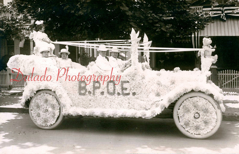 (1914) This float, sponsored by the Shamokin Lodge of Elks, appeared in a Shamokin parade in 1914.  The man driving the car in this picture is William B. Lewis, who owned the J.H. and C.K. Eagle Silk Mill in the early 1900s. The women seated in the back are Williams' wife, Anna L. Lewis, left, and Elizabeth Lewis Scott. The man in the passenger seat is Jacob Neihoff. The child is Florence Winkelspect. The picture was most likely taken outside the Williams' home on Sixth Street, Shamokin.