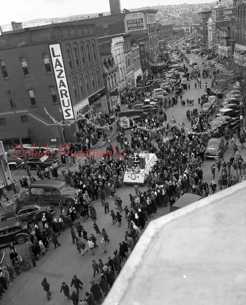 (1949 or 1950) Parade down Independence Street.