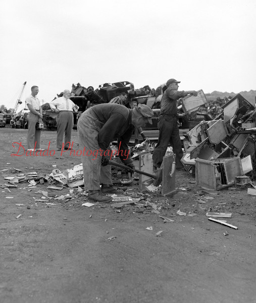(July 1954) Destroying some lottery machines.