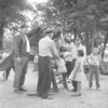 (08.29.57) A small portion of the 1500 children who attended a Coal Township police outing for youngsters. Pictured is, from left, Gary Ditty, a member of the police force, Lester Weaver, center, William Shuey, chief of police, right.