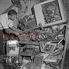 "(08.16.53) Cpl. Frank Damian, of the Shamokin Detail, Pa. State Police, puts the sledge to a number of slot machines during ""Operation Smash-up."" The machines were confiscated from various clubs and establishments in the region."