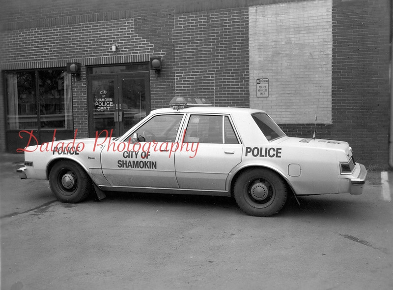 A modern-day police car in front of the old station near Sixth Street.